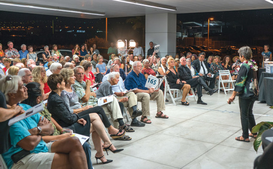 Bidders gather for the 10th Annual Art Auction at BMW of Hawaii. photo courtesy of DMAC
