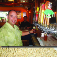 Kona Brewing Company CEO and President Mattson Davis draws a draft from the lineup of barrel-aged specialty beers that are served exclusively at Kona Brewpub.