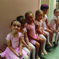 Dancers ages five and six wait patiently for Miss Grace to call them onto the dance floor for their Saturday morning ballet/tap combo class. photo courtesy of Kona Dance and Performing Arts