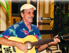 Randy performing at Cafe Pesto in Hilo 2017. photo by T. Ilihia Gionson