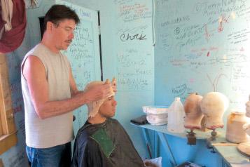 Brian Fuhrer gives Pedro Ka'awaloa horns for Beauty and the Beast (2013). photo by Suzi Bond, courtesy KDEN