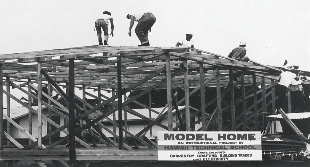 Students work on the framing of an early model home in the 1960s. Note the billboard–Hawai'i Community College was still Hawaii Technical School at the time. photo courtesy Hawai'i Community College
