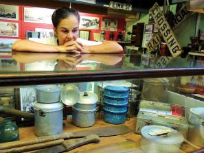 """I think the most iconic symbol of the era was the kaukau tin,"" says museum volunteer Donna Johnson. photo by Catherine Tarleton"