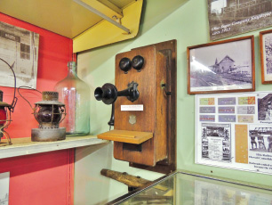 An antique wall-crank ringer phone from the Kohala Ditch, donated by Clarence and Edith Keawe. photo by Catherine Tarleton