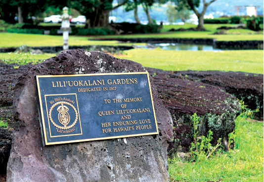 A plaque reminds visitors that the gardens are dedicated to Lili'uokalani and her aloha for Hawai'i's people. In the distance, a Japanese lantern and Waihonu fishpond. photo by T. Ilihia Gionson