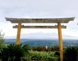 One of Lili'uokalani Garden's torii gates frames Mauna Kea across Hilo Bay. Torii gates mark the transition into a sacred space. photo by T. Ilihia Gionson