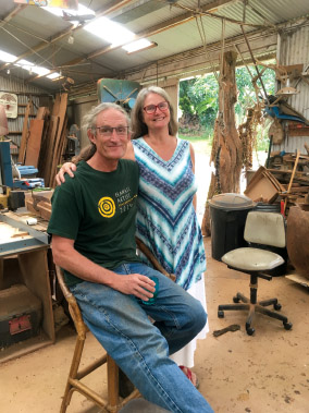 Hosts Tai and Mary Jo Lake in their workshop. photo by Karen Valentine