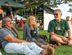 Artists chillin' at the auction, from left, O'ahu woodturners Pat Kramer and Sharon Doughtie with Austrailian scupltor John Van Der Kolk. photo courtesy of Hawai'i Artist Collaboration