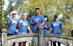Team Sure Blue at Lili'uokalani Park (Nancy Anderson, Julie Miller, Shane Castillo, Susan Kaneshiro, and Rose Perry). They have explored most of East Hawai'i with their walking moai (mutual support group). photo courtesy of Lisa Cabalis, Blue Zones Project