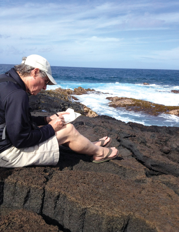 John Dawson sketching at Richardson's Beach Park in Hilo. photo by Kathleen Dawson