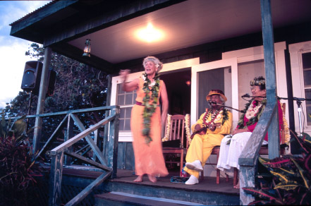 Aunty Queenie Dowsett, Uncle George Naope, and Aunty Nona Beamer grace the porch of Kalāhuipua'a in a priceless magical twilight kanikapila of fun, talk story, and music. photo courtesy of Aaron Miyasato