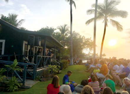 Guests enjoying sunset, music by Kahulanui, and talk story at Twilight at Kalāhuipua'a. photo by Gayle Greco