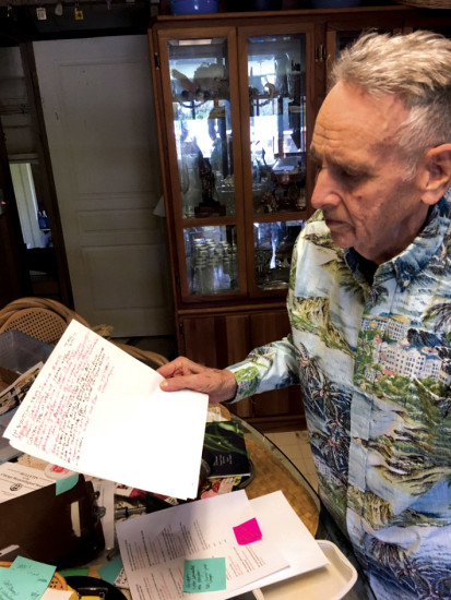 Paul Breese compiles his memories and thoughts for his book; color coding with black ink for his first draft, and in red ink for fact checking. photo by Ma'atu Tukuafu