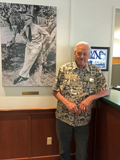 Deputy Director Bruce Taylor stands by the historic photo of former Army Chief of Staff and US President Dwight D. Eisenhower, who visited KMC in 1946. photo by Karen Valentine