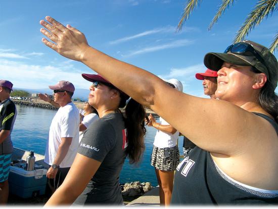 Waʽa crew member Keomailani Case takes some sun sights. photo by Jan Wizinowich