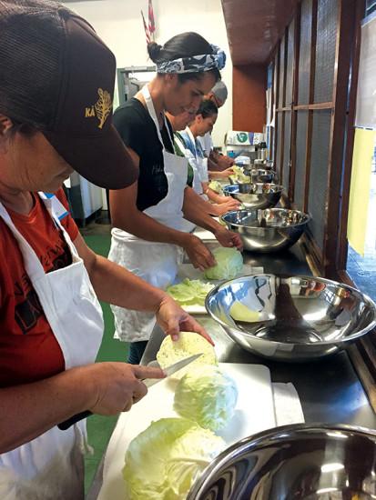Hanauna Ola land crew prepares sauerkraut in Laupāhoehoe. photo courtesy of Keala Kahuanui