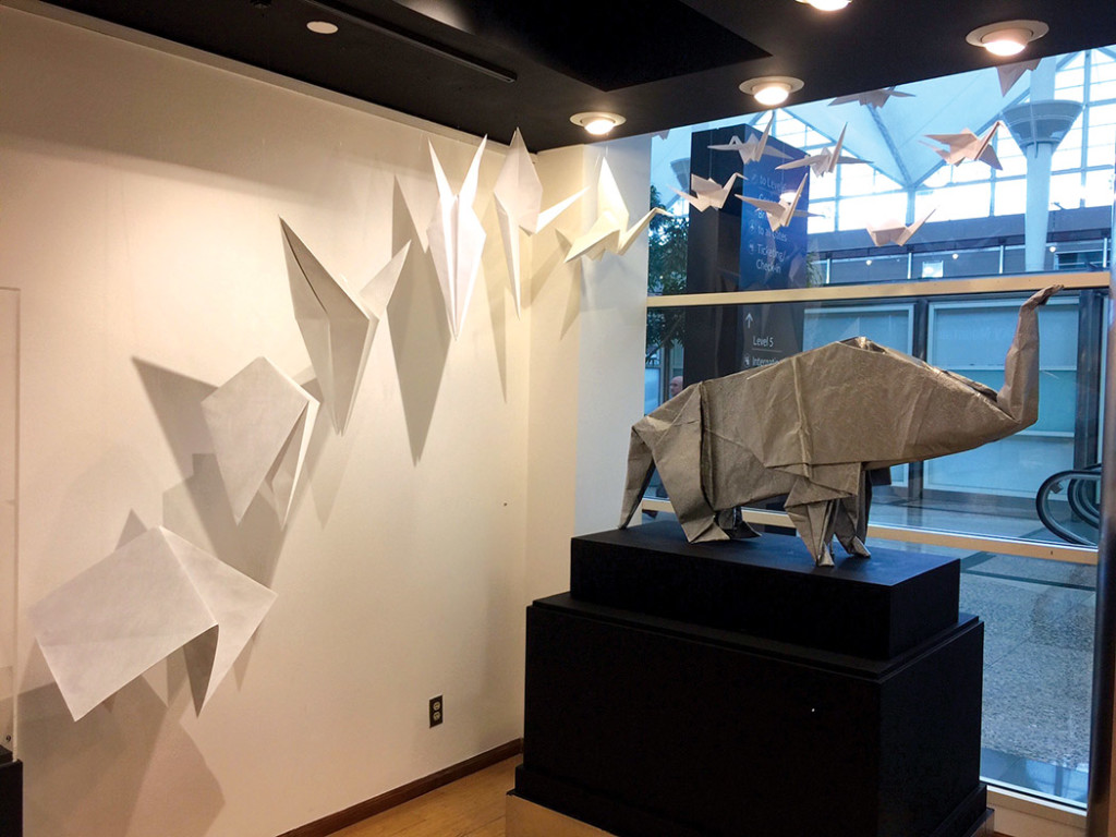 A dinosaur with soaring birds. All pieces are folded with just one sheet of paper and not cuts. photo courtesy of Denver International Airport