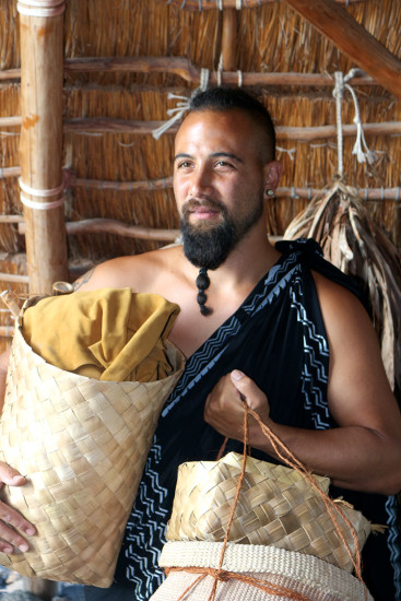 Kahaka'io holding traditional lauhala baskets. photo by Lara Hughes